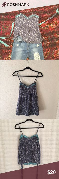 Floral babydoll top Navy blue and turquoise top. Strings to tie a bow in the back. American Eagle Outfitters Tops Camisoles