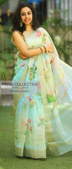 PV 3824 : Blue and pink Floral Organza Price : Floral printed organza sari with golden zariUnstitched blouse piece : Blue plain silkFor Order 10 August 2018 Chiffon Saree, Organza Saree, Traditional Fashion, Traditional Sarees, Traditional Outfits, Traditional Wedding, Floral Print Sarees, Saree Floral, Floral Prints