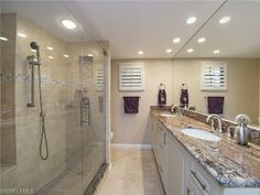 Traditional Dark Blue Master Bathroom With Cream Glazed Cabinets - Bathroom renovations naples fl