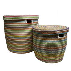 Small Woven Flat Lid Basket - Multicolour:  A best seller at Alresford Linen Co. These baskets, woven in Africa, are a great item to have in your home. Whether they're used for laundry in a bedroom or toys in a playroom they provide great storage, stylishly.  - One of a kind product, size, shape and colour will vary slightly - Woven of plastic strips and millet grass - Handles allow for easy portability - Lidded top - Wipe clean