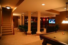 Awkward pillars or support beams in your basement? Make them part of the style by dressing 'em up with mouldings!