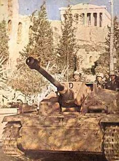 """German Sturmgeschütz """"assault gun"""" tank in Greece, below the Athenian Acropolis. The 'Parthenon' temple is visible in the background. During the war, Stugs were Germany's most produced armoured fighting vehicles. They would see action under various flags, as late as the 1960's in the Middle East."""