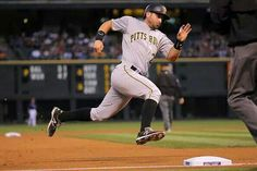 Pirates pound the Rockies - Francisco Cervelli of the Pittsburgh Pirates rounds third base to score on a double by teammate Jordy Mercer during a game against the Colorado Rockies on Sept. 21 in Denver. The Pirates won - © Doug Pensinger/Getty Images Duke Basketball Tickets, Baseball Playoffs, Baseball Scores, Baseball Live, Basketball Goals, Basketball Leagues, Basketball Pictures, Basketball Uniforms, Baseball Field