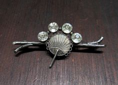 What a beautiful, elegant Victorian Aesthetic Period brooch this is, with four old cut foil-backed paste stones and a Japanese-influenced naturalistic branch and fan motif, set in sterling silver circ