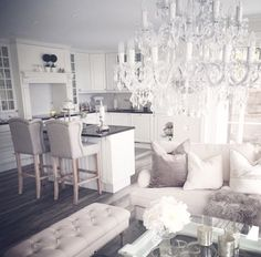 Dream chandelier! I would have to add more color, but the room is very pretty.