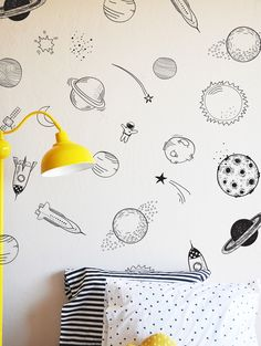 "Hand drawn space - Die Cut Decal - WALL DECAL 2 tall space ships- 11.5""h 2 wide space ships - 11""h 4 shooting stars - 7""w - 11""w 4 clusters of space debris - 6""w - 7""w 16 planets ranging from 4"" w - 1"