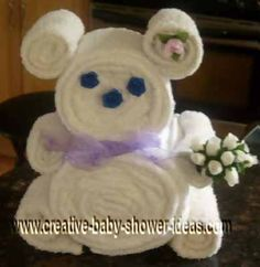 My grandmother loves teddy bears, but since she'll get about 5 bears for Christmas already I found this craft. So she will get towels this Christmas in the shape of a teddy bear. She's another person who is hard to buy for.