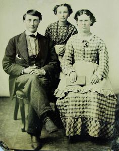 ANTIQUE TINTYPE PHOTO OF HANDSOME YOUNG MAN & 2 LOVELY GIRLS IN PRETTY DRESSES (post cw)
