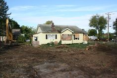 September 19th 2012 - Before the new office could be built, the land had to be cleared, and this dilapidated house had to be removed from the property.