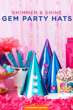 For your preschooler\'s Shimmer and Shine birthday party, create or buy delightful party hats for all your guests, like these ones made of shiny craft paper and colored gems in blues, whites, pinks, and purples. They\'re genie-rrific!