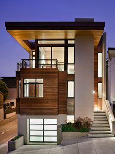 Fachada de una casa de tres niveles y tres generaciones   Casas y Fachadas