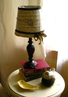 Cover a lampshade with sheet music.  I'd do this a bit differently, but the sheet music is a good idea.