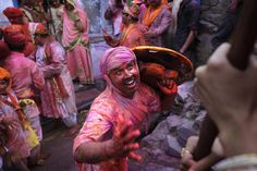 A villager from Nandgaon teases an Indian woman from Barsana village during the Lathmar Holi festival, the legendary hometown of Radha, consort of Hindu God Krishna, in Barsana  Read more here: http://blogs.sacbee.com/photos/2013/03/celebrating-holi-2013-in-india.html#storylink=cpy