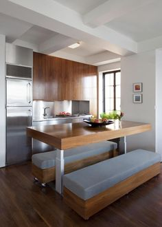 In the kitchen area, Garneau designed a table which can be adjusted to three heights for three functions
