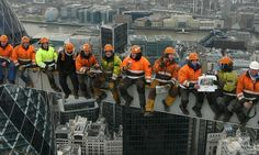 The photo - modelled on Charles C Ebbets's famous 1932 original - was taken by Michael Crompton, 61, as he worked on Heron Tower in central London last year.