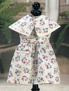 J'aime Ma Bleuette : 203 Quatorze Juillet Lot Number:  203 costume #28 from Spring/Summer 1957,white cotton sundress printed with bursts of red and blue flowers,along with matching short cape and waist sash. The costume commemorated French Bastille Day. Realized Price:  $200
