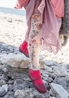 We digitally printed a pattern directly from a watercolor. Curling flowers and birds adorn the outside of the leg and at the top we have our extra elastic waist that fits many waistlines.