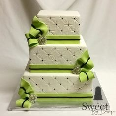 Fondant wedding cake with green bows by Sweet By Design in Melissa, TX