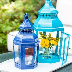 Outfit colored lanterns with an additional burst of color -- fresh flowers. Arrange lanterns of different colors and sizes for maximum impact.