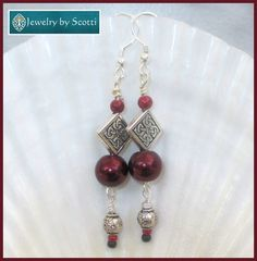 Jewelry by Scotti: Burgundy Pearl and Silver Earrings, 925/10 Silver Filled Hooks, Carved Pewter Bead Earrings, Garnet Silver Jewelry, Elegant Long Earrings www.etsy.com/listing/451847796