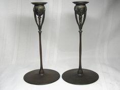 "Louis Comfort Tiffany (1848-1933) - Poppy Stem Candlesticks. Patinated Bronze. New York. Circa 1902-1905. 9-7/8"" x 4-7/8""."