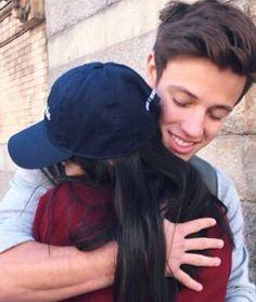Cameron hugging a fan yesterday
