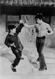 """Bruce Lee helping his friend, Unicorn Chan (yes, Unicorn Chan), to choreograph his film, """"Fist of the Unicorn""""."""