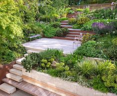 A steep, sloping site is transformed with layers of cascading plants and Corten steel Steep Hill Landscaping, Sloped Backyard Landscaping, Hillside Garden, Garden Bridge, Garden Wall Designs, Garden Design, Steep Gardens, Concrete Retaining Walls, Garden On A Hill