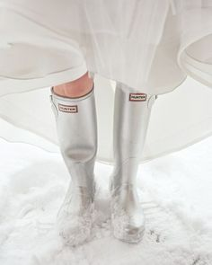 For her wedding in Jackson Hole, Wyoming, bride Dorothy tackled the snow in silver Hunter boots that stayed (mostly) hidden under her wedding dress. Winter Wedding Shoes, Wedding Boots, Winter Bride, Wedding Attire, Winter Weddings, Wedding In The Snow, Wedding Dresses, Bride Boots, Snowy Wedding