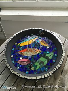 Feather-themed mosaic bird bath by our student Cleo.  Made with stained glass pieces and glass nuggets. Beautiful!