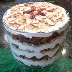 Carrot cake trifle made with vanilla pudding, toasted almonds and coconut, and toffee bits is a fun twist on the traditional carrot cake. Trifle Dish, Trifle Desserts, Trifle Recipe, Just Desserts, Delicious Desserts, Dessert Recipes, Icing Recipes, Frozen Desserts, Tiramisu