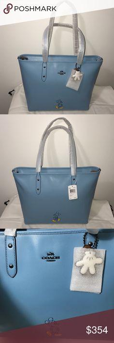 "Disney X Coach Mickey Blue Calf Leather City Tote One of Disney's most beloved illustrations of all time stars on this collectible, go-everywhere COACH tote crafted in beautifully rich calf leather and accented with tongue-in-chic hangtags. 17 1/2"" (L) x 11 1/2"" (H) x 6 1/4"" (W) Inside zip, cell phone and multifunction pockets Handles with 9 1/2"" drop  Zip-top closure, fabric lining Disney x Coach limited edition Style No: 56645 Calf Leather MSRP $325 + $29 tax. Includes original Coach dust…"