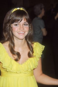 Sally Field in yellow ( I remember those little pin curls on the side )