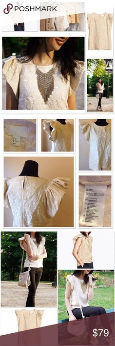 H&M Conscious Exclusive collection rare top size 8 H&M Conscious Exclusive collection top size 8. This is a boho with a romantic a twist puffed sleeve too. The style is gorgeous and the quality is great. This is a hard to find top as only limited quantities were produced. H&M Tops Blouses