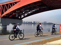 Cycling Beside the Han River (South Korea). 'Beneath the traffic-clogged highways that shadow the course of the Han River is a string of grassy parks linked up by kilometres of cycle lanes. Joining in the pedalling fun is easy, as the city maintains bicycle-hire stations at various points along the river.' http://www.lonelyplanet.com/south-korea/seoul