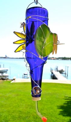 Dragonfly and Lotus Flower Hummingbird Feeder from Recycled Beer Bottle - And what if you turn it into a glassy windchime?