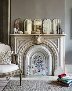 cute fireplace styling…love the butterflies in lucite box