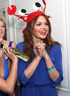Host Aimee Teegarden makes the crab hat look so good