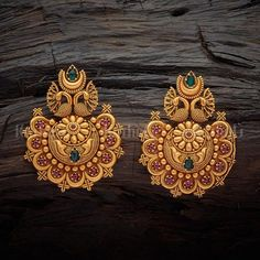 Designer antique earrings studded with synthetic ruby green stones, plated with gold polish, made of copper alloy Indian Jewelry Earrings, Gold Jhumka Earrings, Jewelry Design Earrings, Gold Earrings Designs, Jewelry Tags, Gold Jewellery Design, Gold Jewelry, Jewellery Box, Designer Jewellery