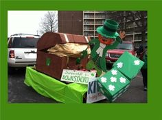 St. Patrick's Day Parade Float with leprechaun, shamrock dice, and gold in a treasure chest.