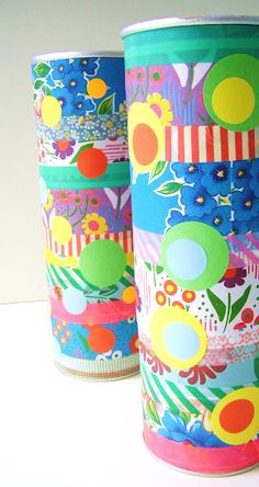 Make these happy containers out of empty Pringle cans - idea from silly old suitcase