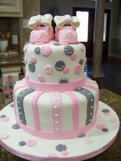 Pink & Gray baby shower cake - Vanilla cake, bc icing, covered in fondant w/ handmade sugar shoes