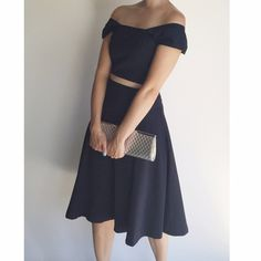 """Two piece outfit. crop top & high waisted skirt. Navy blue. Fully lined. Heavy high quality rayon. Back zipper on skirt and side zipper on the crop top.                                                                     skirt: Waist: 32""""  Size: medium.                                                        Crop Top:                                                                Bust: 34-35"""" I turned this dress into two pieces. High quality & well made outfit. The straps can be shoulder…"""