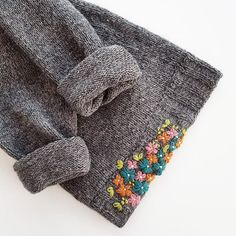 """Lily Fulop on Instagram: """"The worn out edge of a sweater becomes an embroidered flower bed with #visiblemending 🌸🌼🌸🌼 This lovely work is by @ella_with_thread 👏🏻…"""""""