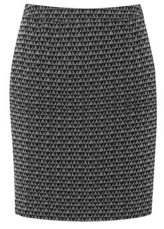 Hand woven pencil skirt in 100% cotton. Fully lined jacquard pencil skirt with covered button fastening and invisible zip. Length 54cm.