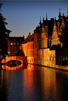 At twilight in Bruges, Belgium. Sometimes referred to as the Venice of the North, the city's historic centre is a prominent World Heritage Site of UNESCO. Places Around The World, Oh The Places You'll Go, Travel Around The World, Places To Travel, Places To Visit, Around The Worlds, Romantic Places, Beautiful Places, Beautiful Streets