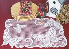 Butterflies are always a popular luncheon lace placemat pattern.  Set of 4 $23.95