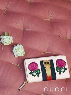 0d298f4d9804 Embroidered flower appliqués embellish the new Sylvie zip around wallet  from Gucci Cruise 2018 by Alessandro