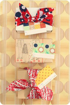 Cute tags and wrapping with fabric!!! Bebe'!!! Love the bright fabric bows!!!
