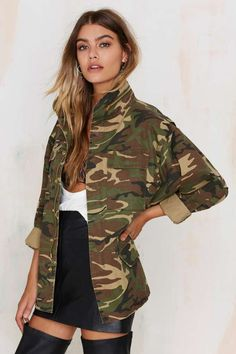 The Femme Fatality Jacket comes in camo print and features a relaxed silhouette, zip and snap-button front closure.